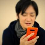 man_using_phone